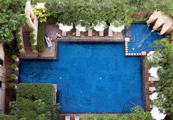 bikini wearing woman at pool in phnom penh's best hotel